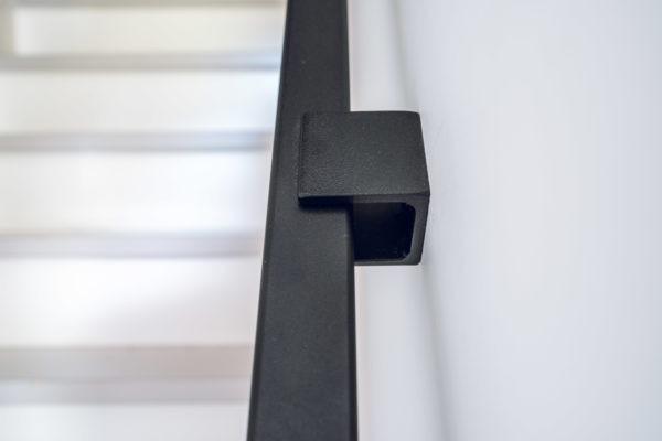 Vierkante trapleuning