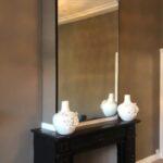 stalen spiegel boven schouw boven haard